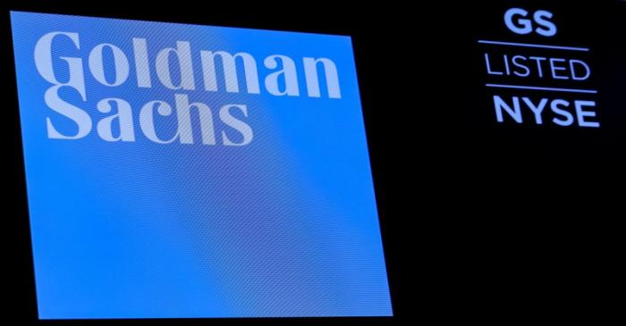 FILE PHOTO: The ticker symbol and logo for Goldman Sachs is displayed on a screen on the floor