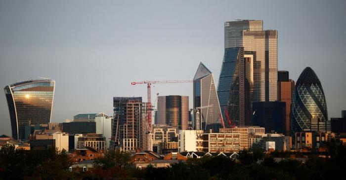 FILE PHOTO: Skyscrapers in The City of London financial district are seen during sunrise in