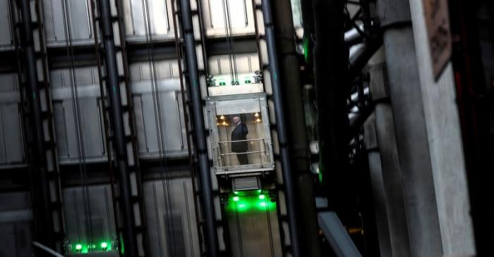 FILE PHOTO: A man takes a elevator in the Lloyds of London building in the financial district