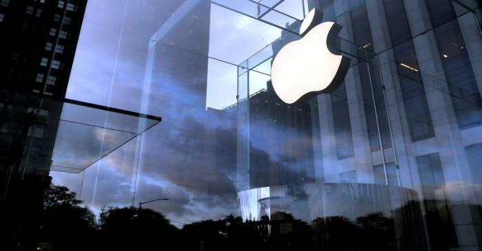 FILE PHOTO: The Apple Inc. logo is seen hanging at the entrance to the Apple store on 5th
