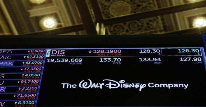 The logo of the Walt Disney Company is displayed above the floor of the New York Stock Exchange
