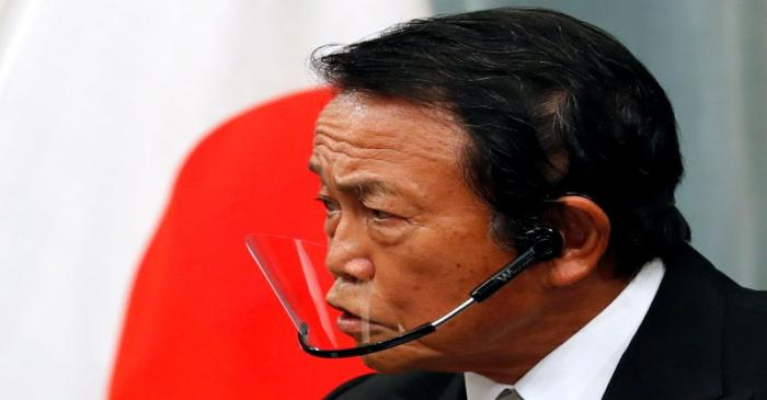 FILE PHOTO: Japan's newly-appointed Finance Minister Taro Aso speaks at a news conference in