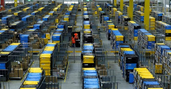 FILE PHOTO: Employees handle packages at an Amazon logistic center in Mannheim