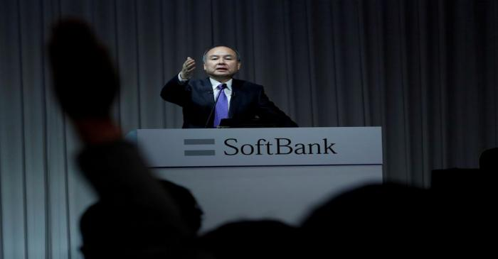 FILE PHOTO: A journalist raises her hand to ask a question to Japan's SoftBank Group Corp Chief