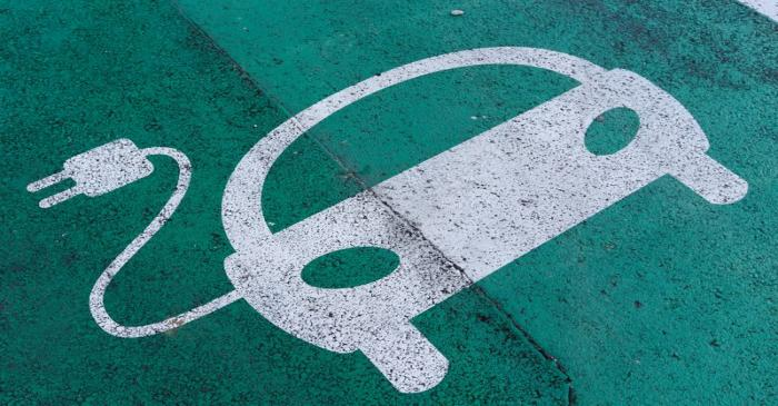 FILE PHOTO: A sign is pictured on an electric car charging station at the United Nations in
