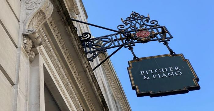 FILE PHOTO:  Signage for a Pitcher & Piano bar is seen in London