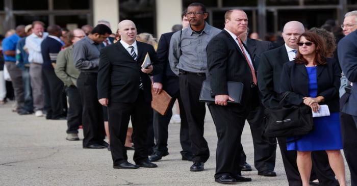 People wait in line to enter the Nassau County Mega Job Fair at Nassau Veterans Memorial