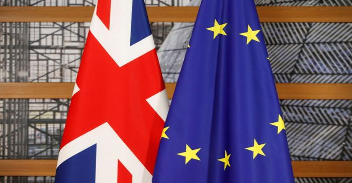A Union Jack flag and a European Union flag are seen ahead of a bilateral meeting between