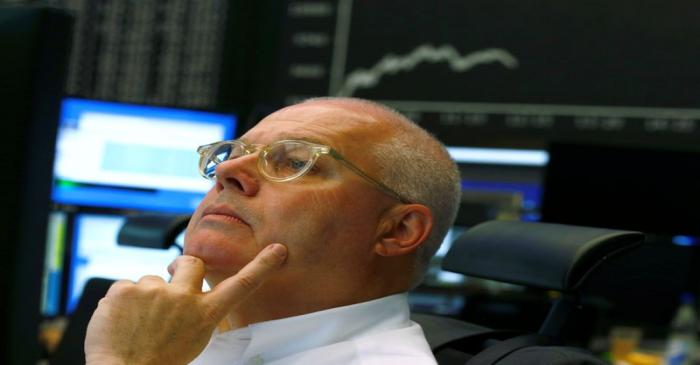A traders reacts at stock exchange in Frankfurt