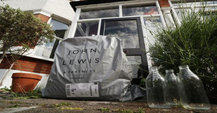 An online delivery package from British retailer John Lewis Partnership is seen on the doorstep