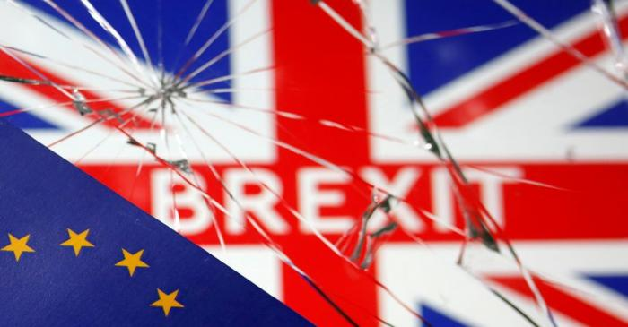 FILE PHOTO: EU flag are placed on broken glass and British flag in this illustration picture