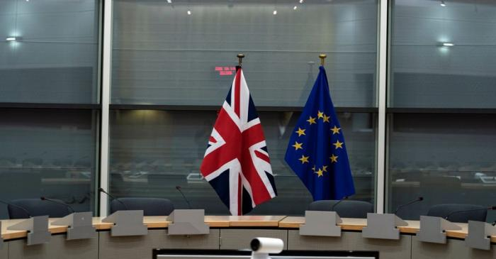 British Union Jack and EU flags are pictured before the meeting with Britain's Brexit Secretary