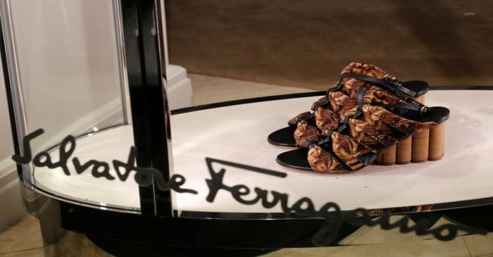 A pair of shoes of Italian luxury shoemaker Salvatore Ferragamo is displayed in the window of