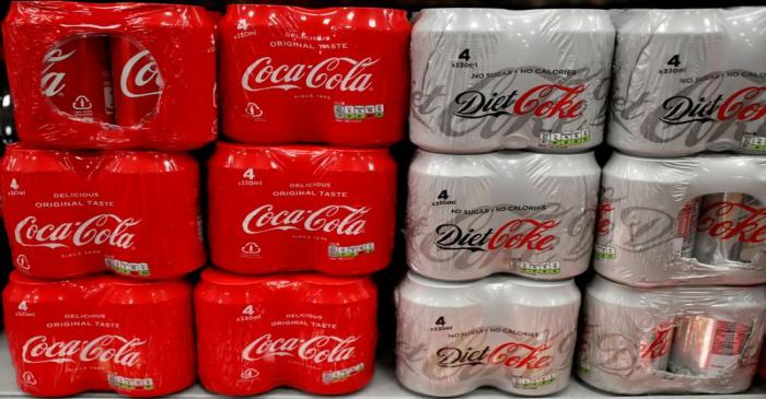 FILE PHOTO: Multi can packs of Coca Cola and Diet Coke are seen for sale in a motorway services