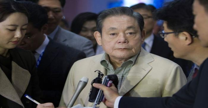 FILE PHOTO: Samsung Electronics Chairman Lee listens to a question from a reporter after