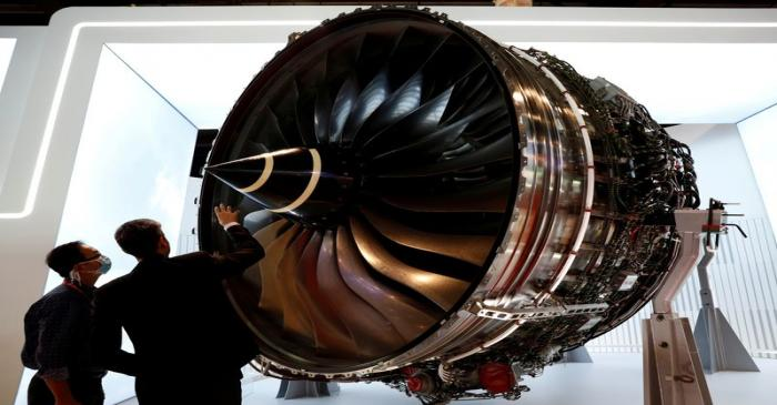 FILE PHOTO: A man looks at Rolls Royce's Trent Engine displayed at the Singapore Airshow in