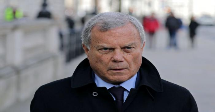 Sir Martin Sorrell walks down Whitehall, as a meeting takes place addressing the government's