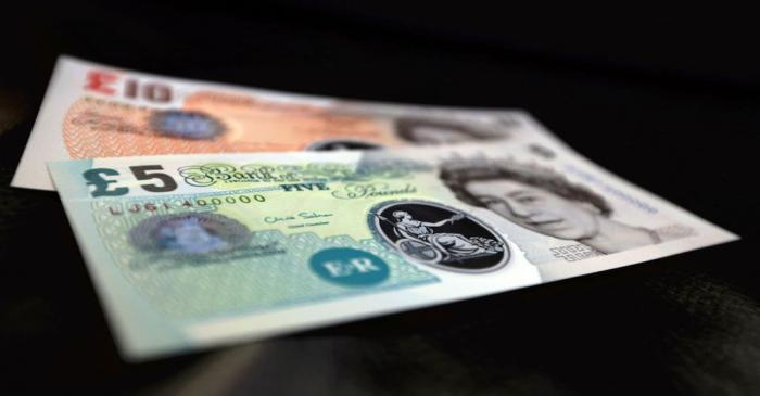 Sample polymer five and ten GB pound banknotes are seen on display at the Bank of England in