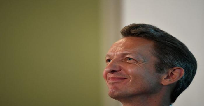 The Chief Economist of the Bank of England, Andy Haldane, listens from the audience at an event