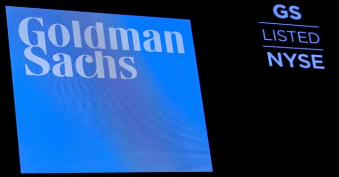 FILE PHOTO: FILE PHOTO: The ticker symbol and logo for Goldman Sachs is displayed on a screen