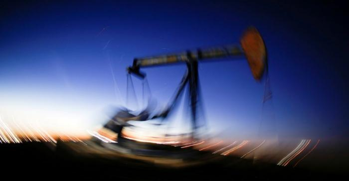 FILE PHOTO: A long exposure image shows the movement of a crude oil pump jack in the Permian