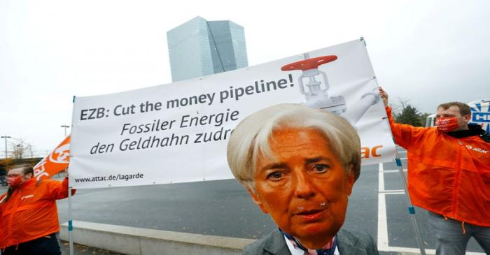 FILE PHOTO: Activists protest against the European Central Bank's fossil fuel bond buying,