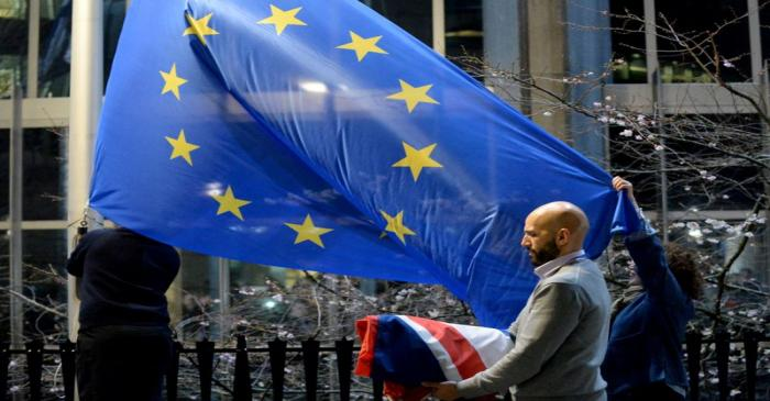 coWorkers replace the British flag outside the European Parliament building with the European