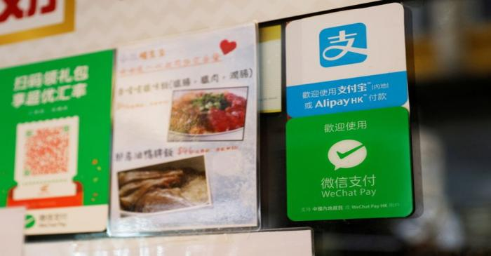 Logos for digital payment services Alipay by Ant Group, an affiliate of Alibaba Group Holding
