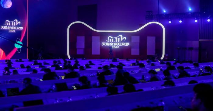 Members of the media attend the Alibaba Group's 11.11 Singles' Day global shopping festival at