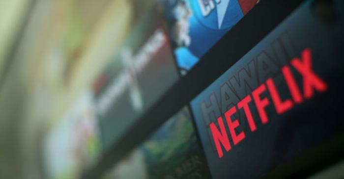 FILE PHOTO: The Netflix logo is pictured on a television in this illustration photograph taken