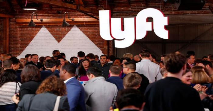 FILE PHOTO: People mingle following the 2019 listing of Lyft on the Nasdaq at an event in Los