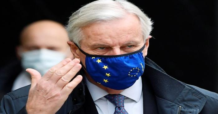 European Union's chief Brexit negotiator Michel Barnier wearing a face mask walks to Brexit