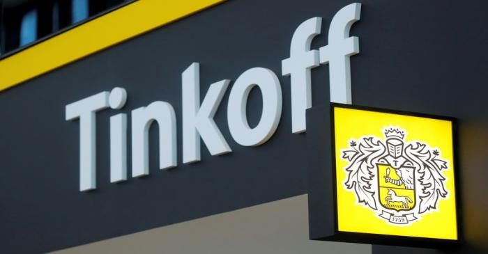 FILE PHOTO: The logo of Tinkoff Bank is seen on a board at the St. Petersburg International
