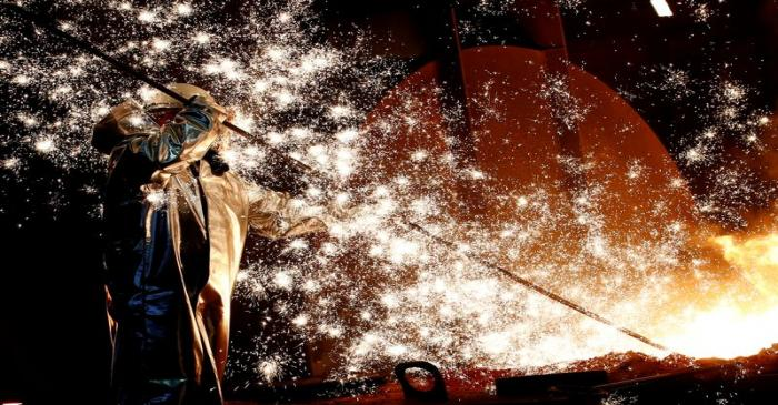 FILE PHOTO: A steel worker of Germany's industrial conglomerate ThyssenKrupp AG stands a mid of