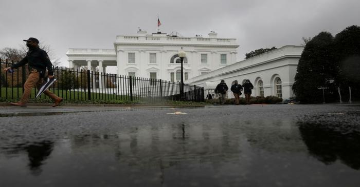 FILE PHOTO: Rain falls over the White House during a storm in Washington