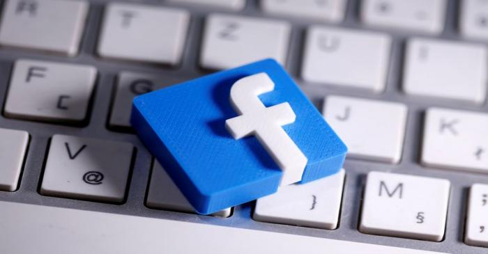 FILE PHOTO: A 3D-printed Facebook logo is seen placed on a keyboard in this illustration