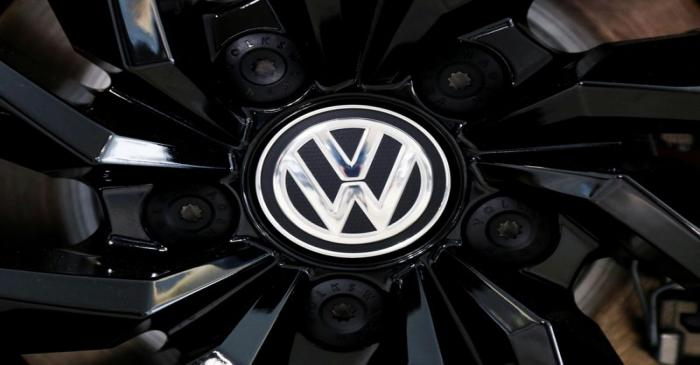 FILE PHOTO: The logo of German carmaker Volkswagen is seen on a rim cap in a showroom of a
