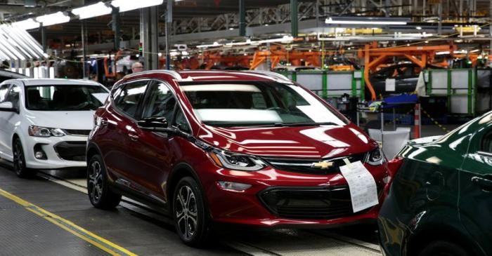 A red 2018 Chevrolet Bolt EV vehicle is seen on the assembly line at General Motors Orion