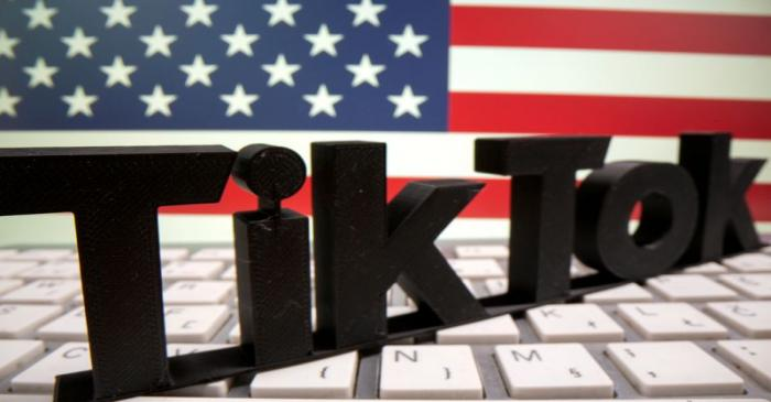 FILE PHOTO: A 3D printed TikTok logo is placed on a keyboard in front of U.S. flag in this