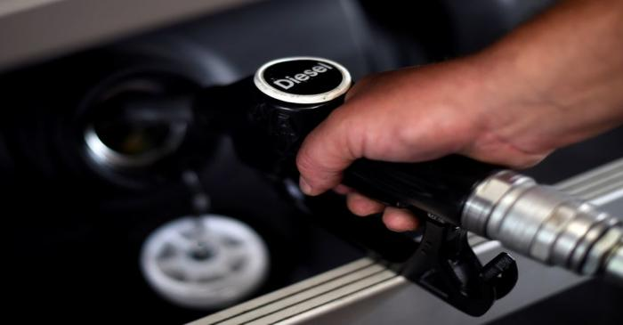 A man fuels his car at a petrol station in London