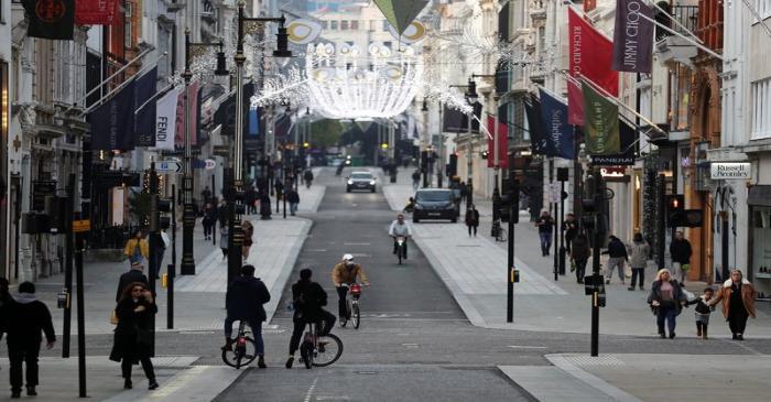 Pedestrians and cyclists move through New Bond Street amid the coronavirus disease (COVID-19)