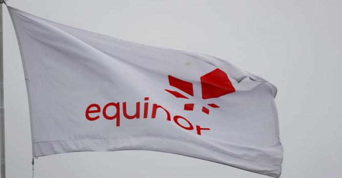 FILE PHOTO: Equinor's flag flutters next to the company's headqurters in Stavanger