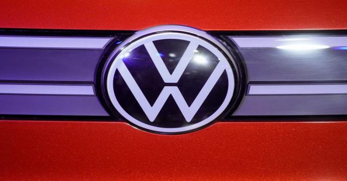 A Volkswagen logo is seen at a construction completion event of SAIC Volkswagen MEB electric