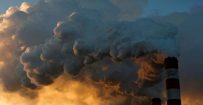 FILE PHOTO: Smoke and steam billow from Belchatow Power Station, Europe's largest coal-fired