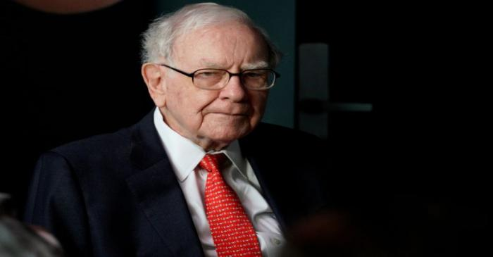 Warren Buffett, CEO of Berkshire Hathaway Inc, pauses while playing bridge as part of the