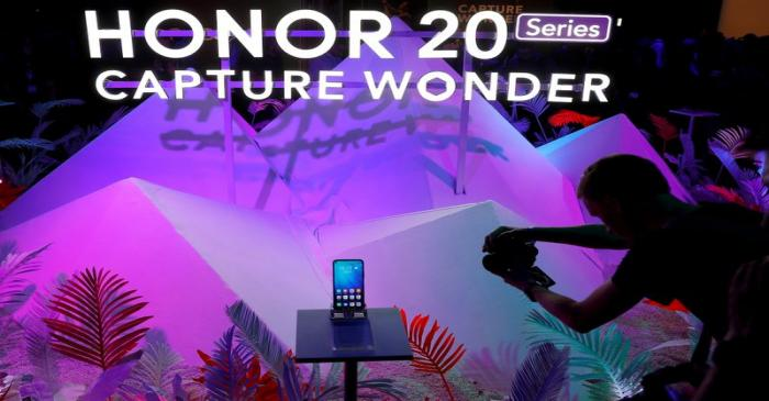 FILE PHOTO: A visitor to the launch of Huawei's Honor 20 range of smartphones photographs the