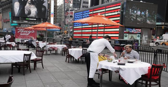 FILE PHOTO: Servers package food at a table at a pop up restaurant set up in Times Square in