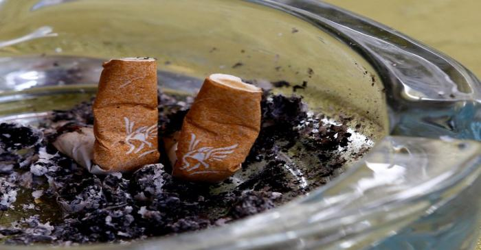 FILE PHOTO: An illustration picture shows discarded Gauloises cigarette butts in an ashtray in