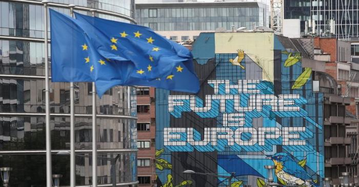 European Union's flags flutter outside the European Commission headquarters in Brussels