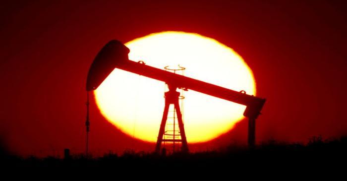 FILE PHOTO: The sun sets behind a pump-jack outside Saint-Fiacre